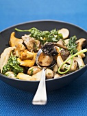Mixed mushroom stir-fry with deep-fried parsley