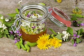 Spruce tips, flower petals and a jar of honey