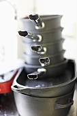 Stacked cast-iron pans