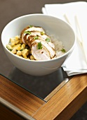 Sliced pork fillet on pearl barley risotto and rice