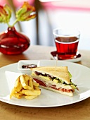 Club sandwich with chips and ketchup