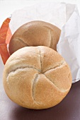 Two bread rolls with paper bag