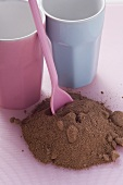 Drinking chocolate and beakers on pink background