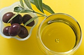 Olive oil and olives in small dish