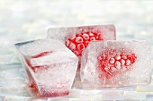 Three raspberry ice cubes