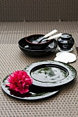 Black Asian tableware with a flower