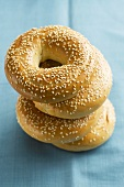 Four sesame bagels, stacked
