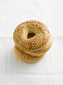 Three sesame bagels, stacked