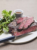 Beefsteak with salad leaves and sauce