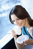 Woman drinking cappuccino