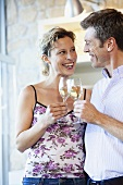 Couple clinking glasses of white wine