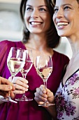 Women with glasses of white wine