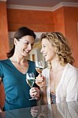 Two women drinking white wine