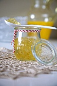 Orange jelly in jar with spoon