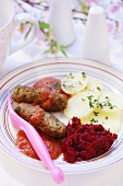 Cevapcici with tomato sauce, potatoes and beetroot (for children)