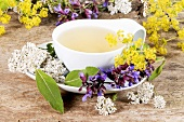 Medicinal tea with yarrow, sage and lady's mantle