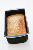 Home-made apple cake in a loaf tin