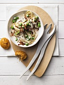 Pasta with fried bacon and peas