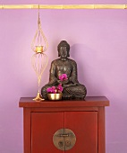 Buddha figure on cupboard