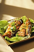 Mackerel fillets on green salad