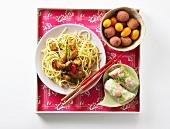 Egg noodles with pork, spring rolls and exotic fruit