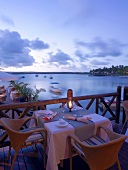 Laid table on terrace on Mauritius at twilight