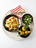 Penne with tomatoes, rocket and mozzarella salad, fruit