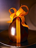 Chocolate egg with gift ribbon