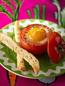 Baked egg in tomato, toast soldiers