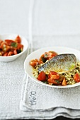 Fried sea bream on pearl barley risotto with tomatoes