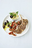 Grilled lamb chops with tomato salsa and aubergine puree