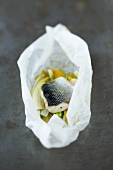 Sea bass with vegetables and orange en papillote