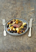 Loin of venison on pancakes strips with chanterelles, blueberries