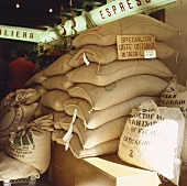 Sacks of coffee beans in the stockroom of a café