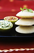 Idli (steamed Indian rice cakes) with chutneys