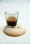 Espresso in glass on almond biscuit