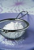 Icing sugar in a sieve