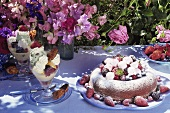 Table with cake, dessert and flowers in the open air