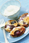 Small cherry cakes with whipped cream