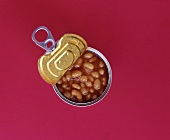 An opened tin of baked beans