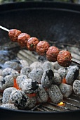 Mince kebab on a barbecue