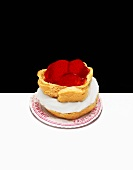 Cream puff filled with strawberries and cream