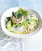 Rice noodles in curry sauce with sprouts and spring onions