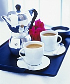 Two cups of espresso and espresso pot on tray