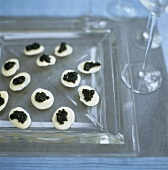 Avruga caviar on white chocolate rounds