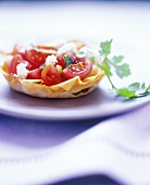 Tomato salad with feta and coriander in pastry shell