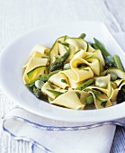 Pappardelle with green asparagus, courgettes and beans