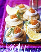 Blinis with crème fraîche and smoked salmon