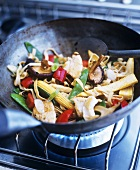 Noodles with chicken and vegetables in wok