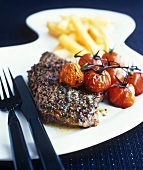 Peppered steak with cocktail tomatoes